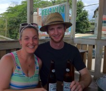 Enjoying some Belikin beer at an outdoor bar.